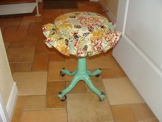 I gave this little lady a new skirt (or hat) depending on which way you look at her. Vintage stool.