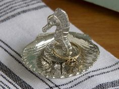 This seahorse pewter ring holder, discovered by The Grommet, will keep your precious rings safe, while being beautiful at the same time.