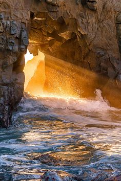 "Pfeiffer Arch near Big Sur, California.  ""I am the Angel of the Sun, Whose flaming wheels began to turn When God's almighty breath Said to the Darkness and the Night, Let there be light! And there was light!"" – Henry Wadsworth Longfellow from ""The Angels of the Seven Planets"""