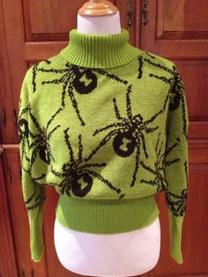 Vintage Green Spider Turtle-neck Sweater Manufactured By: Betsey Johnson One Size Made in USA 30% Wool 70% Acrylic Measurements: Length: 27