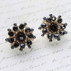 Black Glass & Pearl Cluster Bead Clip Earrings, £12.00 by Queenies Bazaar:  Item: Earrings (Clip) Size: 2.8cm Condition: Very good - Showing slight wear Designer or Brand: Unsigned  Description: Beautiful wearable vintage at affordable prices. These lovely genuine vintage clip-on earrings feature faceted black & pearl glass beads in a cluster design.  Lightweight, easy to wear with strong and comfy clips. Measuring approximately 2.8cm wide. Silver plated tone backs. Unsigned - Possibly…