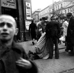 A Jewish policeman dragging a Jewish woman.