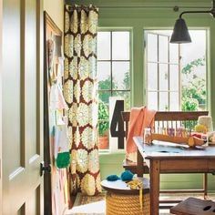 """Pittsburgh Paints' Dill would also do well in a foyer or mudroom as a transition from the outside, or in a windowed room where yellowish green can make a space feel as if it extends outdoors. """"It looks great with white trim, and it works well with any amount of natural or artificial light,"""" says Dee Schlotter, who tracks research on color and design for PPG Pittsburgh Paints. """"Unlike some neutrals, it's saturated enough to not take on other colors when the light changes..."""