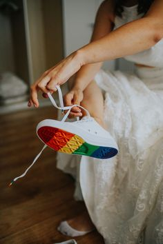 Add a subtle nod to Pride at your same-sex wedding by rocking these rainbow-soled sneakers! Shop the gorgeous lace bridal skirt now at http://houseofollichon.co.uk/shop #pride #samesexwedding #lesbianwedding
