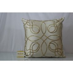 This Silver Cream Color in Silk Cushion Cover with cut dana work in gold color, features back zip; comes with compress poly filler.