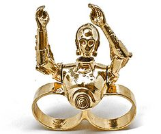 AWESOME AWESOME AWESOME!!! This 2 Finger C3PO Ring is Perfectly Stunning and Geeky COOL! It's C3PO with Movable Arms! SWEET! Are you as Excited as me? It's so Bright and Shiny and Humanoidy even Chewbacca