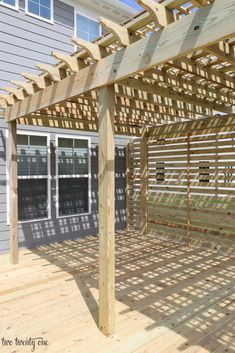 Our deck with pergola is finished! And it took a whopping days for three guys to build it. I detailed in this post exactly what we were looking for in a deck. I even asked you guys to weigh in on the size of the pergola. And for the record, of you voted … Diy Pergola, Pergola Curtains, Small Pergola, Pergola Attached To House, Pergola Swing, Deck With Pergola, Cheap Pergola, Outdoor Pergola, Wooden Pergola