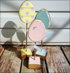Glittery distressed Easter egg trio on stands...