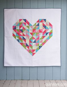 Quilty Love   Hearts on Fire Quilt – Weekend Quilting Blog Hop  http://www.quiltylove.com - Scrappy heart quilt by Emily of quiltylove.