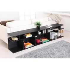 @Overstock - Practical for a variety of home and office rooms, this Katrin black console sofa table features multiple convenient shelves to neatly store, organize, and display your items. The modern and innovative design allows this unit to double as a sofa table.http://www.overstock.com/Home-Garden/Katrin-Black-Wood-Console-Sofa-Table/5483408/product.html?CID=214117 $122.39