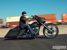 Bad ass 2010 Street Glide.  Love the green pin striping on the flat black.