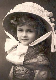 Victorian girl in lovely white hat