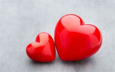 Two red hearts, big and small hearts, background with red hearts, romance concepts