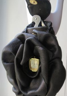 Le Corsage: Flower shaped wine key holster with watch.