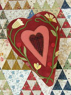Folk art, heart pillows from a wife and mother from Northern England.