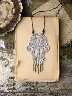 Lace necklace; you can easily hang chain, charms, beads, etc. off of the lace since it has openings.