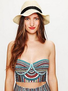 This bustier would be cute with a maxi skirt pulled up to underneath or just below it! B-)