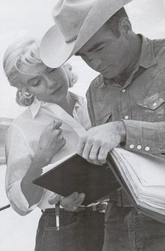 "Marilyn and Montgomery Clift go over the script on the set of ""The Misfits"", 1960"
