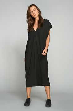 Cut from ultra soft Italian viscose knit. This dress has a relaxed fit, signature draped shoulder seams and a slightly dropped back hem. Fabric: Italian Viscose Elastane Hand Made in Canada Handmade Home Decor, Comfortable Outfits, Emerson, One Size Fits All, Lounge Wear, White Dress, Normcore, One Piece, Gowns