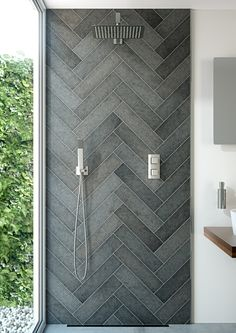 Stunning showering solution by VADO.  Love the tiles too!