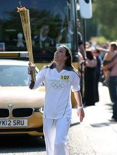 Beth Tweddle with the Flame