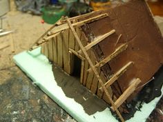 A little article on how I made the saxon houses Tools needed.some green insulating foam, Matchsticks, some thin woodsheeting (an old dra. School Projects, Projects For Kids, Crafts For Kids, Anglo Saxon Houses, Viking House, Cabin Crafts, Making A Model, Viking Art, Classroom Displays
