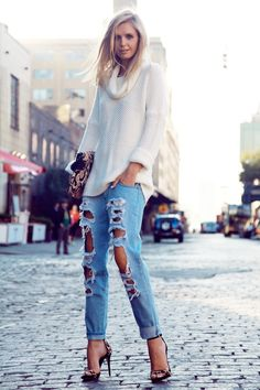 ripped denim and a cozy cowlneck