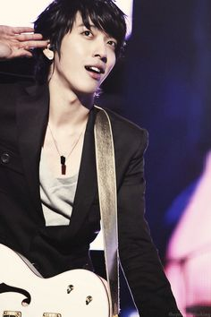 Jung Yonghwa- tell me there is something hotter than a guitar-playing guy.