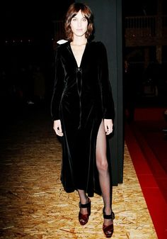 Alexa Chung wears a velvet Prada dress with fishnet tights and Prada heels
