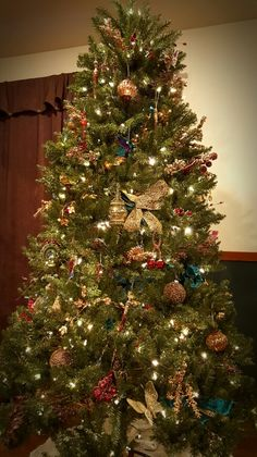 Peacock Christmas tree, gypsy theme, colorful, rich colors, beautiful tree