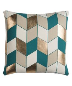 Add bold style to your bed or seating area with this delightfully soft throw pillow.
