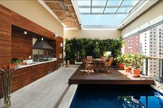penthouse outdoor kitchen + sliding roof + sliding wood deck over pool!