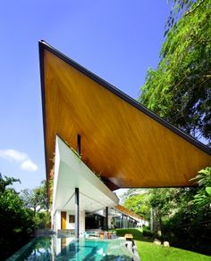 "The Winged House - not sure I could live here but curious about the ""the house itself is climatically responsive to bring comfort to its inhabitants""....  I don't like the stone, but creatively it is something!  K2LD Architects, Malay ""Winged House""    --thanks Sar!  ;)  (Architizer.com)"