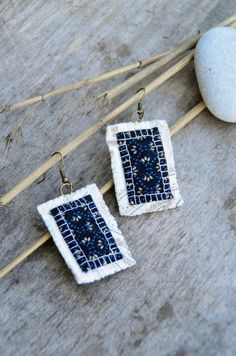 Unique white blue golden black statement earrings with by Mioltu, €17.00
