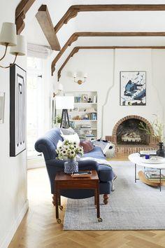 Emily Henderson's updated modern, traditional living room in her Tudor revival.
