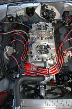 Dodge Charger Engine: circa 1968  426 HEMI with the air cleaner removed reveals two Carter 600cfm Air Valve Secondary (AVS) carburetors. One Mean Machine!
