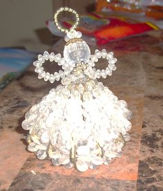 Angel I have on Listia  Made from Safety pins, propeller beads, etc.