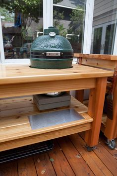 """When I got my Big Green Egg I got the large table to go with it. It seemed okay, not great. I knew I wanted to have a good work surface for my Egg and I didn't think the simple fold out """"wing"""" tables would work at all. I know a lot of Eggheads make their own tables. There are some wonderful plans online that help out. But I don't have even the basic woodworking skills, or patience, to do that. So I just went with the table from the store."""