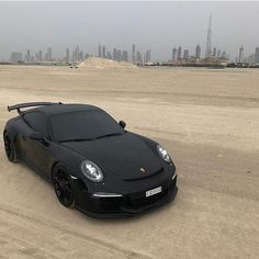 WoW look at this black Beast! Who of you would like to drive this Porsche 991 through the desert of Dubai? Tag A Friend you would like to share this moment Porsche Macan, Porsche Cars, Mclaren P1, Aston Martin, Blacked Out Cars, Ferrari, Lamborghini Aventador, Black Porsche, Red Audi