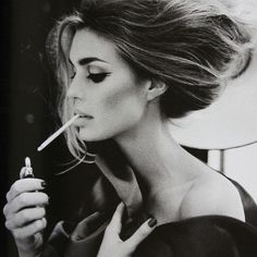 DISGUSTING CIGARETTE;  beautiful hair + makeup! :o)