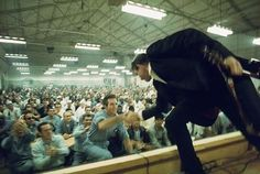 Johnny Cash shaking an inmate's hand at Folsom Prison, 1968.