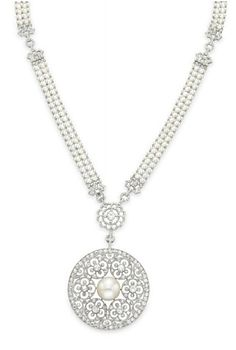 A BELLE EPOQUE PEARL AND DIAMOND PENDANT NECKLACE   Suspending a pierced old European-cut diamond circular pendant, centering upon a button pearl, measuring approximately 13.45 x 13.40 mm, from a single-cut diamond scalloped link, to the four-row seed pearl neckchain, spaced by openwork single-cut diamond links, mounted in platinum, circa 1915, 18¼ ins.