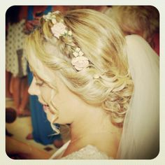 Pale pink and ivory hair vine entwined into this bride's beautiful braided updo. www.bloomingloopy.com