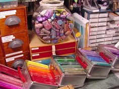 "Love the fish bowl idea to store scrap clay. From the original post:  68428.1       This photo will show you my messy desk along with my storing of polymer clay. I have a big fishbowl that I through my ""extra"" clay. When the bowl gets full I take them out and match up some colors and make some new colors and put them through the pasta machine and fold themm up about 6inch by2 1/2 inches and put them in these lunchboxes by color so they are all ready to go through the pasta machine again…"