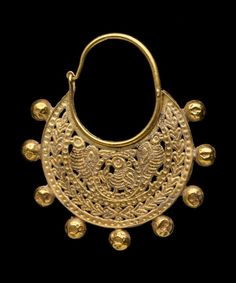 [One of a] Pair of openwork earrings. Gold.  Byzantine -  6th or early 7th century A.D.