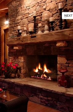 Love the old timber used for the fireplace mantle.  I have an old barn beam that is waiting to be used in our design.