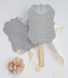 This beautiful handmade die cut wedding program features an elegant ornamental shaped program embellished with a wood stick, perfect to use as