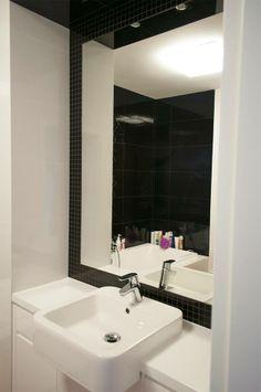 black and white bathroom, half built in washbasin , hatria