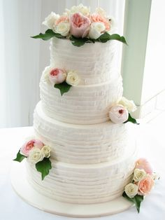 All chocolate mudcake with chocolate ganache filling and covered in piped buttercream pleats. The gorgeous sweet perfumed roses were supplied by The Ivory Bouquet. Check out my page at www.facebook.com/cakesbyleannerhodes