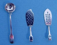 Miniature silver soup ladle and fish/pastry slices by Mike Sparrow